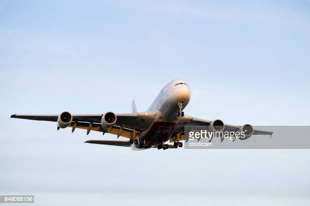 emirates airline a380 airplane - emirates airline stock photos and pictures