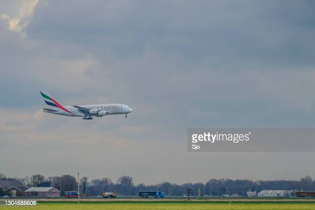 emirates airline airbus a380 approaching schiphol amsterdam airport - emirates airline stock pictures, royalty-free photos & images