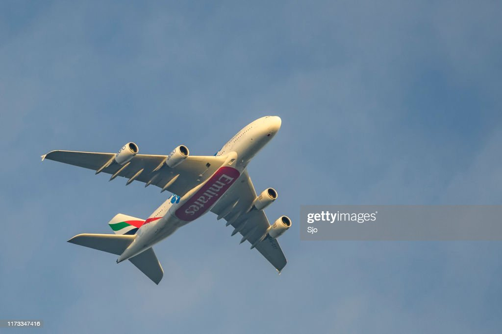 Emirates Airline Airbus A380 flying high up in the air. : Stock Photo