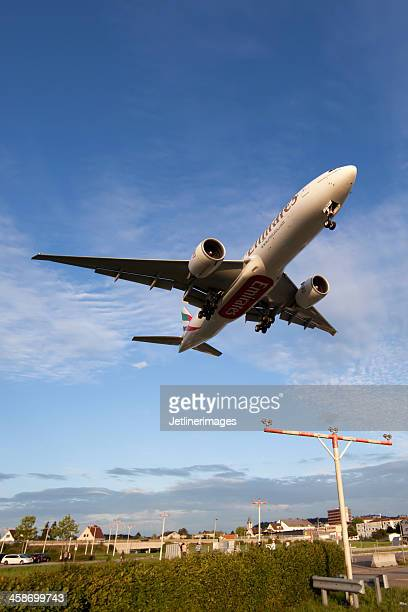 emirates airline boeing 777-200lr - emirates airline stock photos and pictures