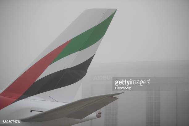 Emirates Airlines livery adorns the tail fin an Airbus SE A380 passenger aircraft ahead of the delivery of Emirates 100th Airbus A380 passenger jet...