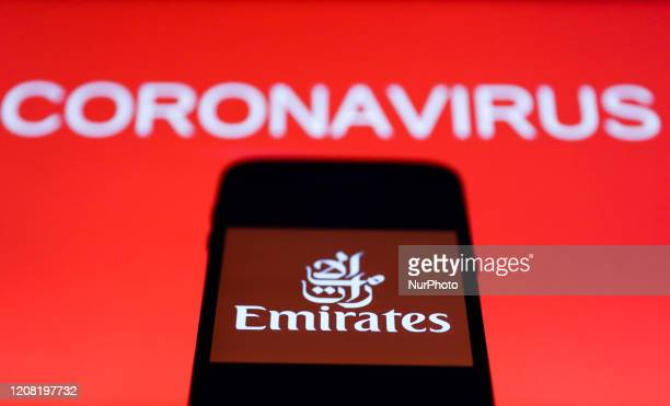 Emirates app icon is seen on the smartphone screen with coronavirus sign in the background in this illustration photo taken in Poland on March 24 2020