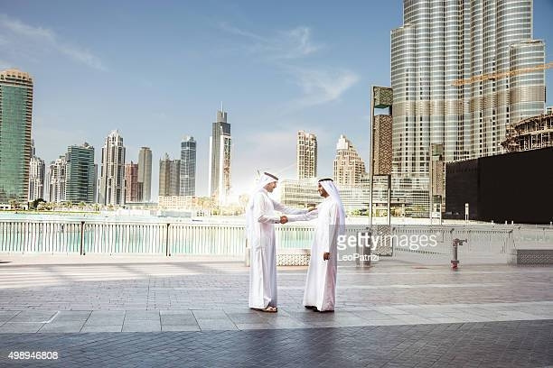 emirates business men downtown dubai - financial district stock pictures, royalty-free photos & images
