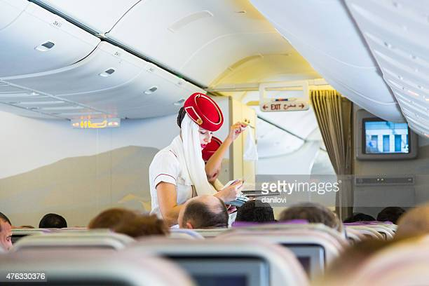emirates cabin crew in economy class - emirates airline stock pictures, royalty-free photos & images