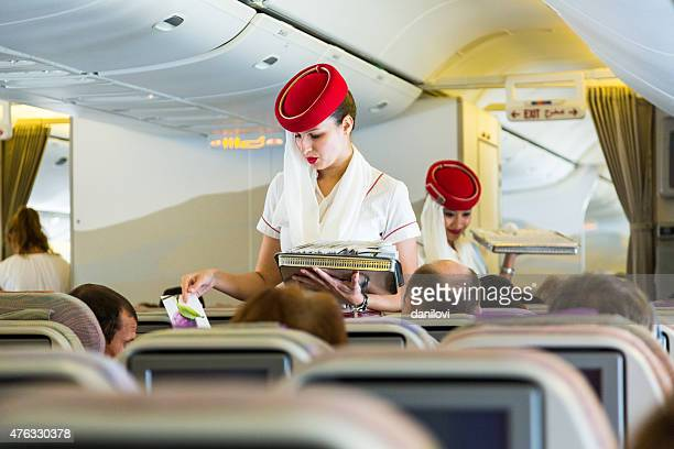emirates cabin crew in economy class - crew stock pictures, royalty-free photos & images