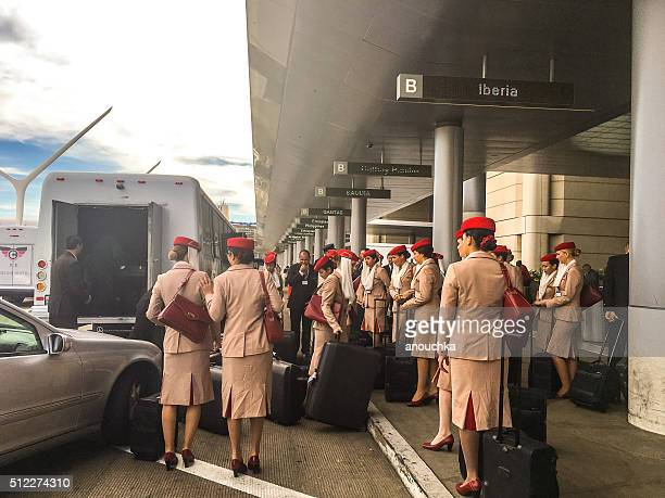 emirates crew members at the entrance to la airport - emirates airline stock photos and pictures