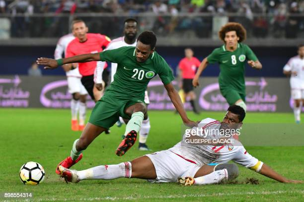 Emirates' Fares Saadi vies for the ball with Saudi's Mukhtar Fallatah during the 2017 Gulf Cup of Nations football match between UAE and Saudi Arabia...