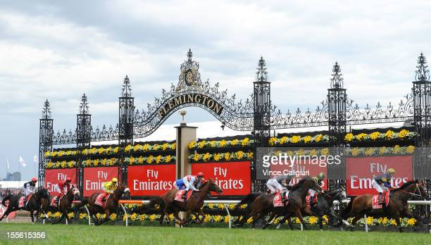 Emirates Melbourne Cup field pass the winning post with one lap remaining during 2012 Melbourne Cup Day at Flemington Racecourse on November 6 2012...