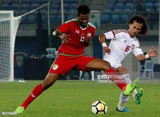Emirates' Mohammad Abdulrahman vies for the ball with Oman's Raed Saleh during their 2017 Gulf Cup of Nations football match between UAE and Oman at...