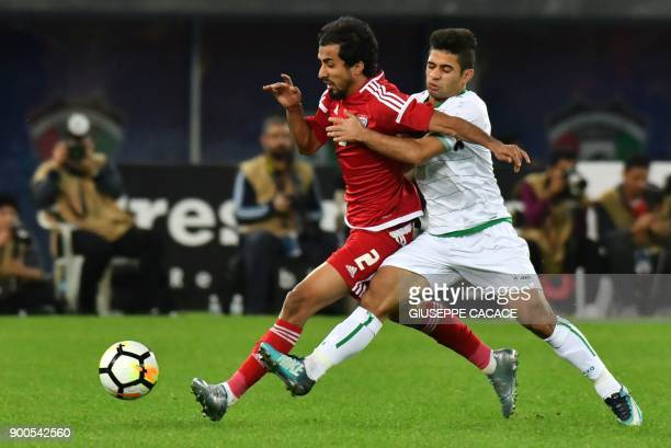 Emirates' Mohammed Barqesh vies for the ball with Iraq's Hussein Ali AlSaedi during the 2017 Gulf Cup of Nations semifinal football match between...