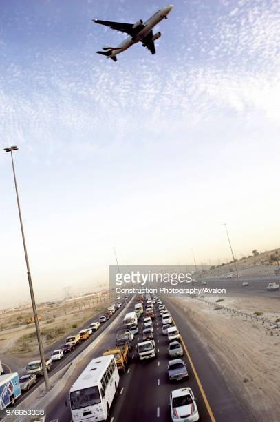 Emirates Road traffic jam aeroplane flying overhead Dubai United Arab Emirates May 15 2005