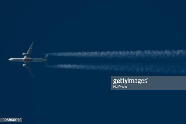 Emirates SkyCargo Boeing 777F overflying Greece in the blue sky at 34000 feet with 465knots The airplane registration is A6EFG and is flying from...