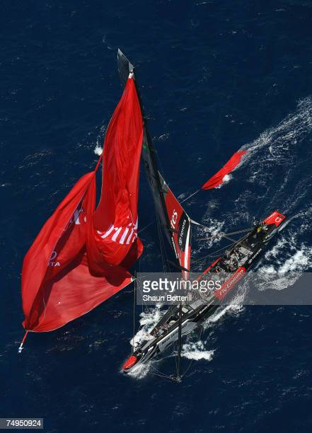 Emirates Team New Zealand bursts a spinnaker racing against Alinghi Team Switzerland during the fifth race of the 32nd America's Cup Match by Louis...