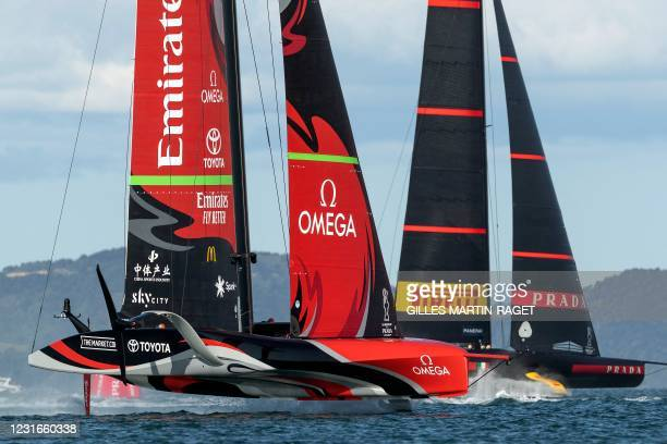 Emirates Team New Zealand competes against Luna Rossa Prada Pirelli during race four on day two of the 36th America's Cup in Auckland on March 12,...