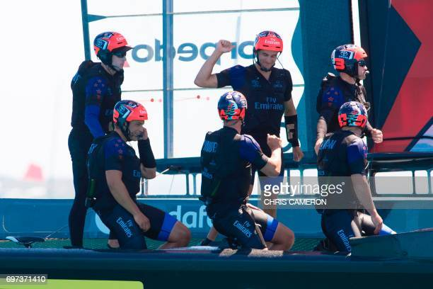 Emirates Team New Zealand crew celebrate after their win against Oracle Team USA in race four during the 35th America's Cup on June 18 in Hamilton...