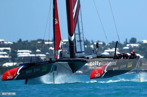 Emirates Team New Zealand helmed by Peter Burling competes against ORACLE TEAM USA skippered by Jimmy Spithill in race 7 on day 4 of the America's...