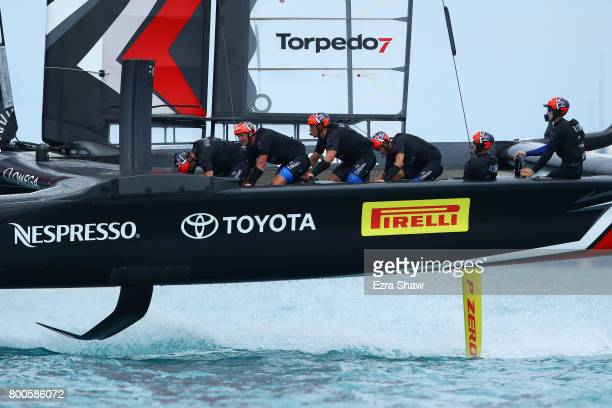 Emirates Team New Zealand helmed by Peter Burling competes with Oracle Team USA skippered by Jimmy Spithill during day 3 of the America's Cup Match...