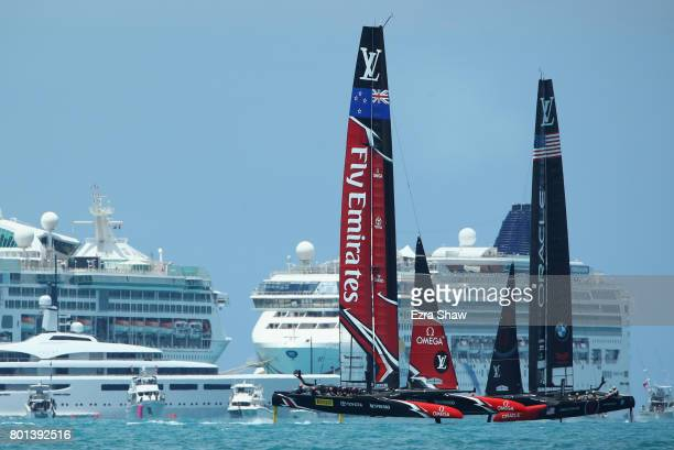 Emirates Team New Zealand helmed by Peter Burling competes with Oracle Team USA skippered by Jimmy Spithill during day 5 of the America's Cup Match...