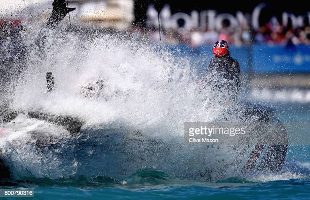 Emirates Team New Zealand helmed by Peter Burling cross the finish line and win race 8 on day 4 of the America's Cup Match Presented by Louis Vuitton...