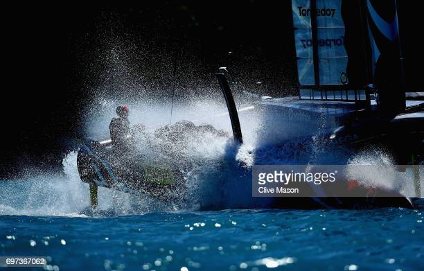 Emirates Team New Zealand helmed by Peter Burling crosses the finish line winning the second race of the day during day 2 of the Americas Cup Match...