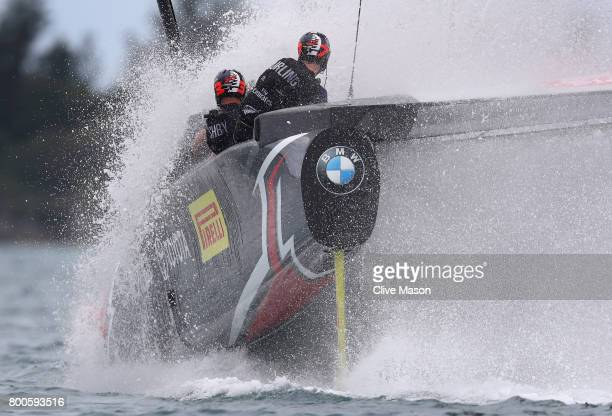 Emirates Team New Zealand helmed by Peter Burling dunks the windward hull as they round a mark during race 6 against Oracle Team USA skippered by...