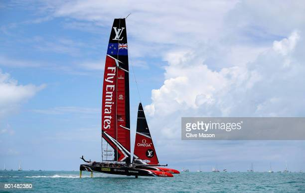 Emirates Team New Zealand helmed by Peter Burling in action racing during race 9 against Oracle Team USA skippered by Jimmy Spithill on day 5 of the...