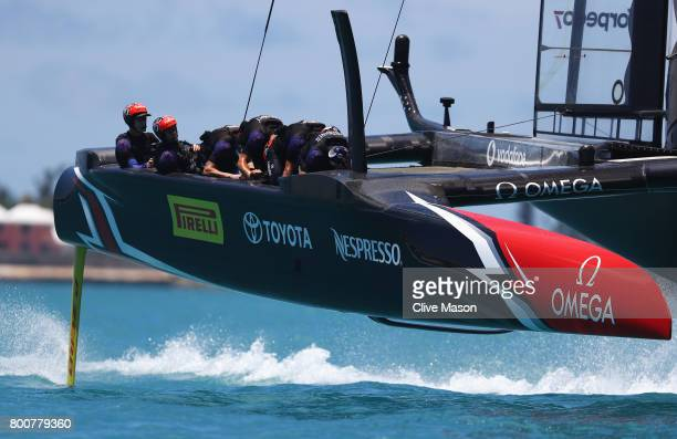 Emirates Team New Zealand helmed by Peter Burling moves into position prior to the start on day 4 of the America's Cup Match Presented by Louis...