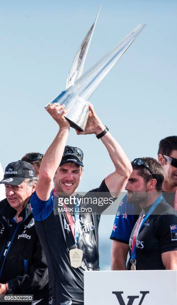Emirates Team New Zealand helmsman Peter Burling celebrates with team mates after winning the race and taking the series 5-2 against Artemis Racing...