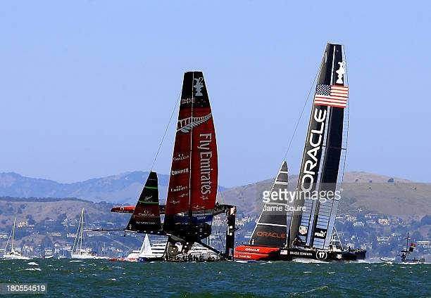 Emirates Team New Zealand nearly capsizes as it races alongside Oracle Team USA during race 8 of the America's Cup Finals on September 14, 2013 in...