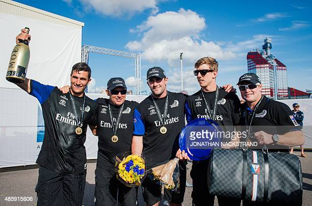 Emirates Team New Zealand poses for a picture after winning the overall at the end of the second and last day of races of the 35th America's Cup...