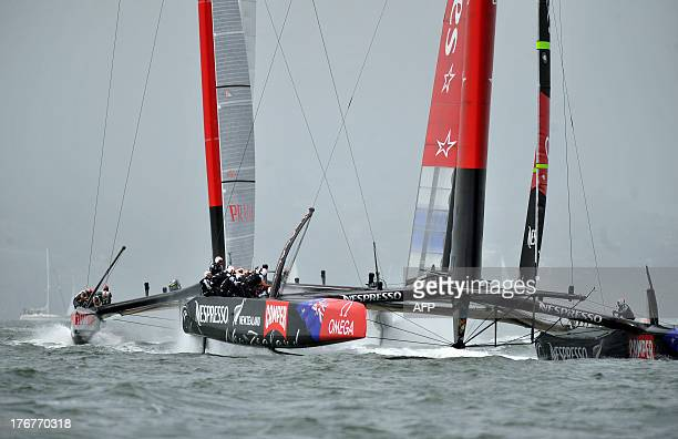 Emirates Team New Zealand pulls ahead of Luna Rossa Challenge at the start of the second finals race of the Louis Vuitton Cup in San Francisco...