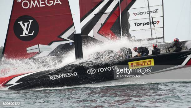 TOPSHOT Emirates Team New Zealand races against Oracle Team USA in the Great Sound during the 35th America's Cup June 24 2017 in Hamilton Bermuda...