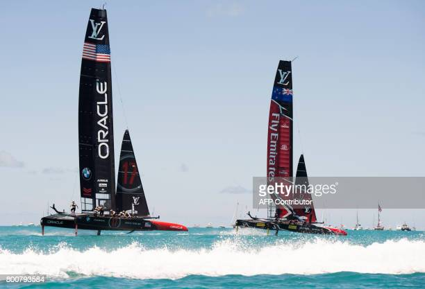 Emirates Team New Zealand races against Oracle Team USA in the Great Sound during the 35th America's Cup June 25, 2017 in Hamilton, Bermuda. / AFP...
