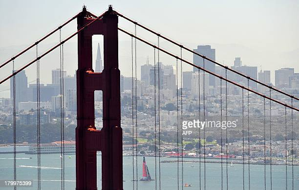 Emirates Team New Zealand sails near the Golden Gate Bridge while preparing to race before the start of the first round of the 34th America's Cup on...