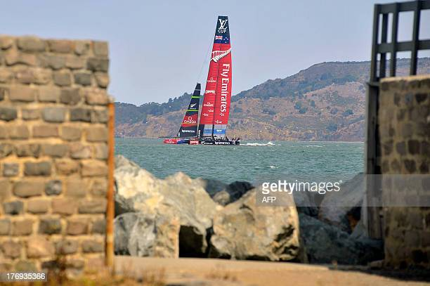 Emirates Team New Zealand sails their AC72 before the start of the third race of the Louis Vuitton Cup in San Francisco California on August 19 2013...