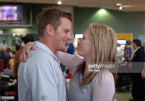 Emirates Team New Zealand skipper Dean Barker is all smiles as he gets a hug from his wife Mandy Smith upon his arrival home at the Auckland Airport...