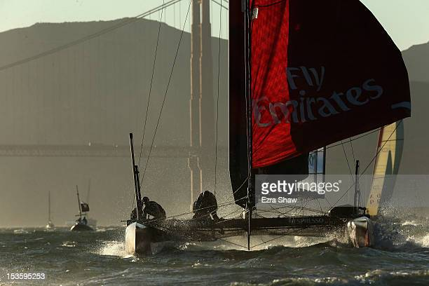 Emirates Team New Zealand skippered by Dean Barker competes in a fleet race during the America's Cup World Series on October 6 2012 in San Francisco...