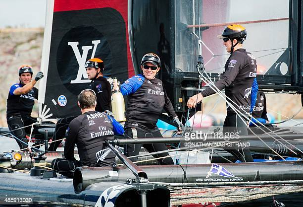 Emirates Team New Zealand skippered by Peter Burling celebrates onboard after winning the overall at the end of the second and last day of races of...