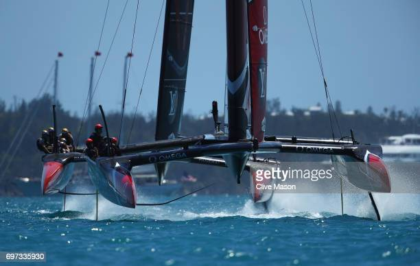 Emirates Team New Zealand skippered by Peter Burling competes with Oracle Team USA skippered by Jimmy Spithill during day 2 of the America's Cup...