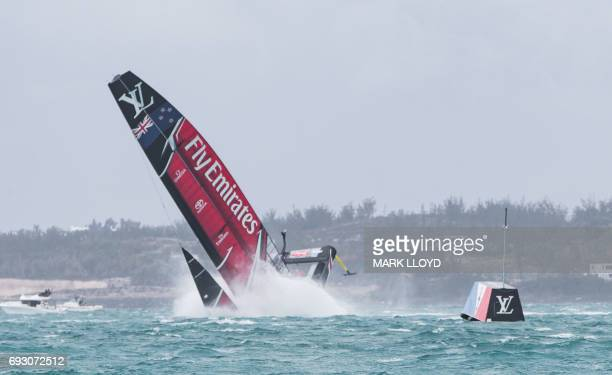 TOPSHOT Emirates Team New Zealand skippered by Peter Burling is seen capsizing their act at the race start in race 5 of the 35th America's Cup...
