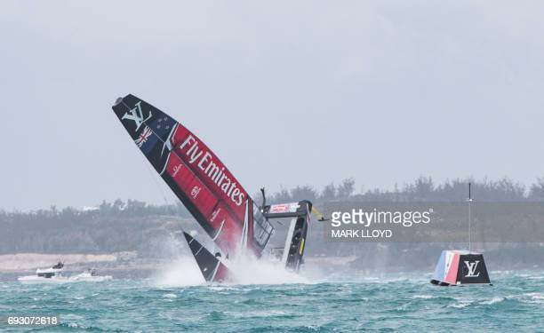Emirates Team New Zealand skippered by Peter Burling is seen capsizing their act at the race start in race 5 of the 35th America's Cup Challenger...