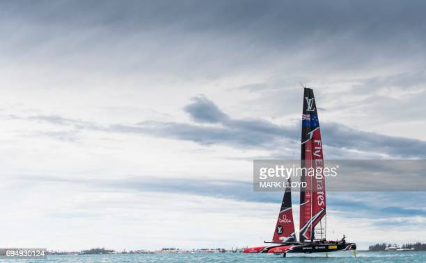 Emirates Team New Zealand skippered by Peter Burling races during the 35th America's Cup Louis Vuitton Challenger Playoffs finals in Hamilton Bermuda...