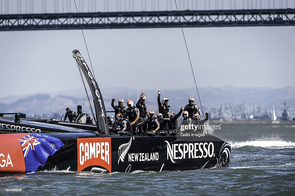 Emirates Team New Zealand wave to their fans on the end of pier 27 during day 4 of the America's Cup on September 12th, 2013 in San Francisco.