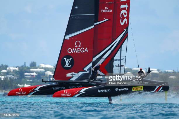 Emirates Team New Zealand with helmsman Peter Burling competes with Oracle Team USA with helmsman Jimmy Spithill during day 1 of the America's Cup...