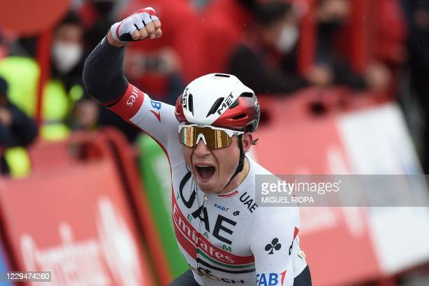 Emirates Team's Belgian rider Jasper Philipsen celebrates as he crosses the finish-line of the 15th stage of the 2020 La Vuelta cycling tour of...