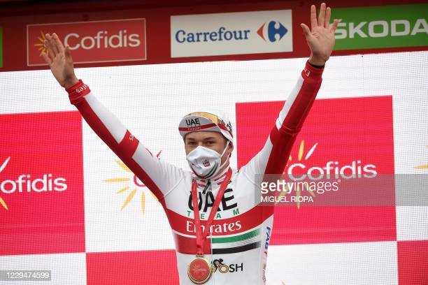 Emirates Team's Belgian rider Jasper Philipsen celebrates on the podium after winning the 15th stage of the 2020 La Vuelta cycling tour of Spain, a...