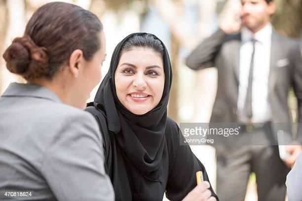 Emirati arab businesswoman at business meeting