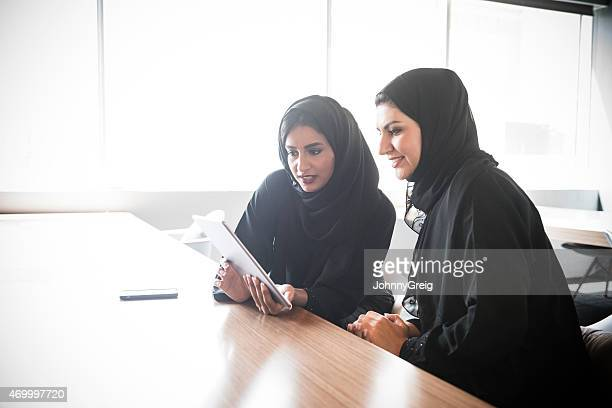 Emirati Arab businesswomen using digital tablet
