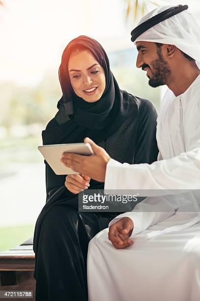 Emirati businessman and businesswoman working together