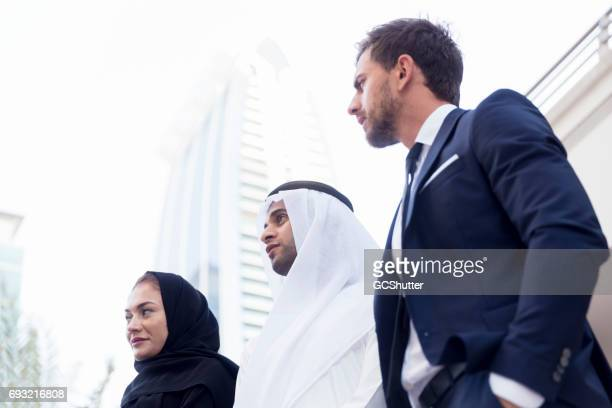 Emirati Businessman collaborating with his colleagues on a business deal
